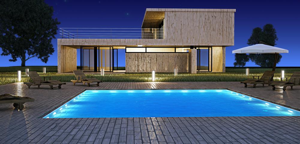 piscine éclairée par des spot immergés et des bornes lumineuses